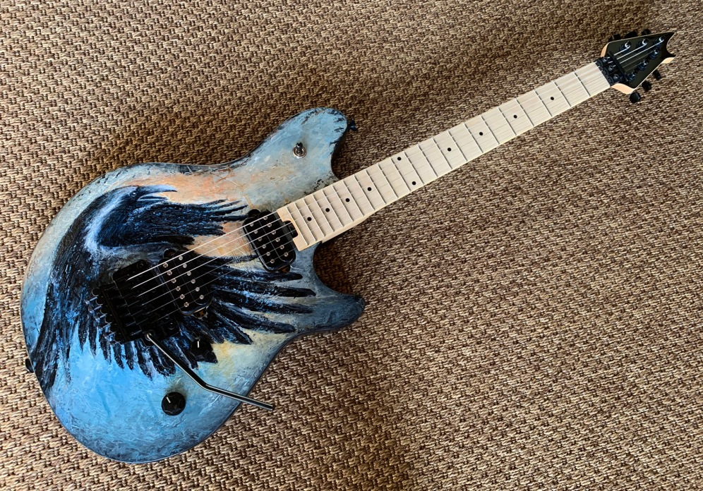Raven Guitar painted for the ArtReach Guitar Auction 2020